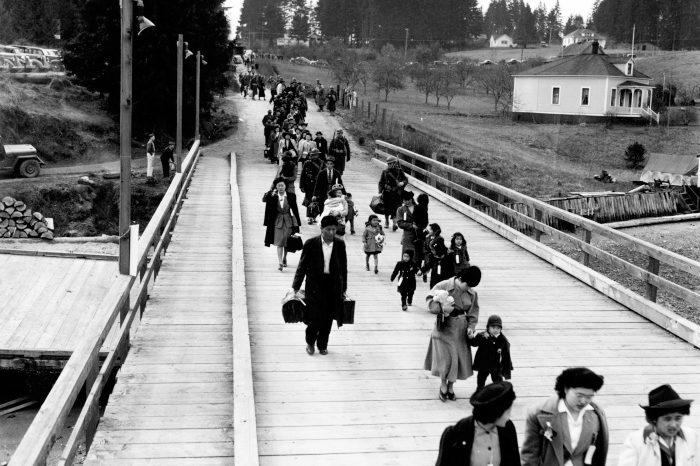 Japanese Americans leaving Bainbridge Island after being forced to relocate to internment camps during WWII