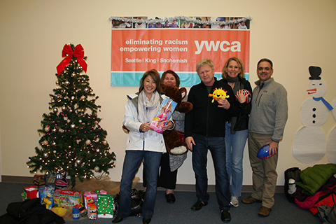 YWCA staff posing with a Christmas tree