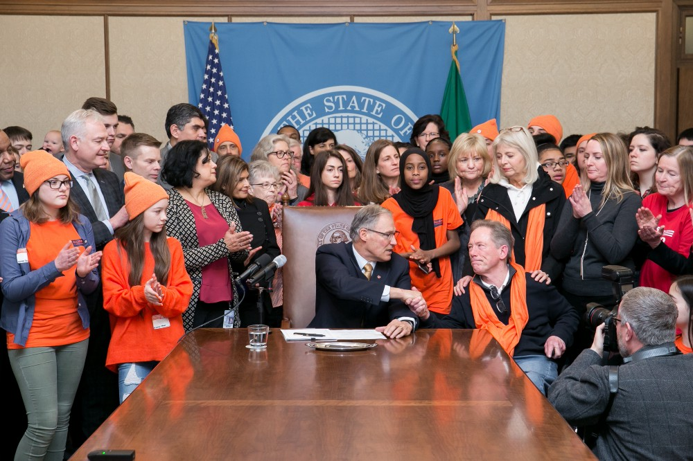 Jay Inslee signs the bump stock ban