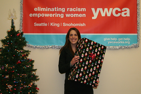 Woman posing with wrapped gift