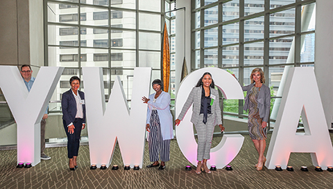 "Guests posing with giant letters spelling ""Y-W-C-A"" at 2019 King County Luncheon"