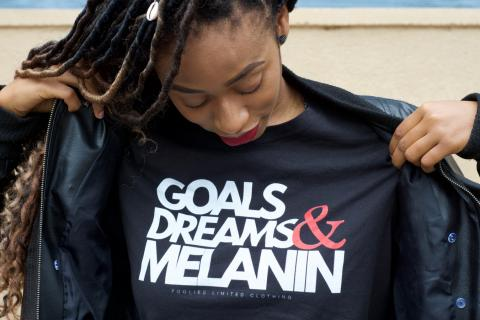 Black woman in melanin T shirt