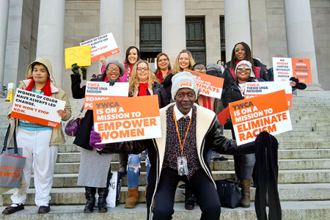 YWCA staff pose in front of the Washington Legislative building during Housing and Homelessness Advocacy Day