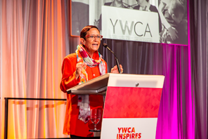 YWCA CEO Maria Chavez Wilcox on stage at 2018 Seattle Luncheon