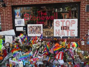 The Stonewall Inn with flowers and signs after Pride Weekend, 2016